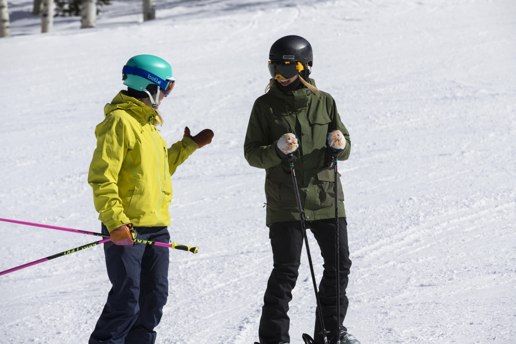 Ski instructor Robin Barnes talks to her student on the slope