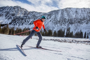 PSIA-AASI National Team member Greg Rhodes skate skis in front of the A-Basin East Wall
