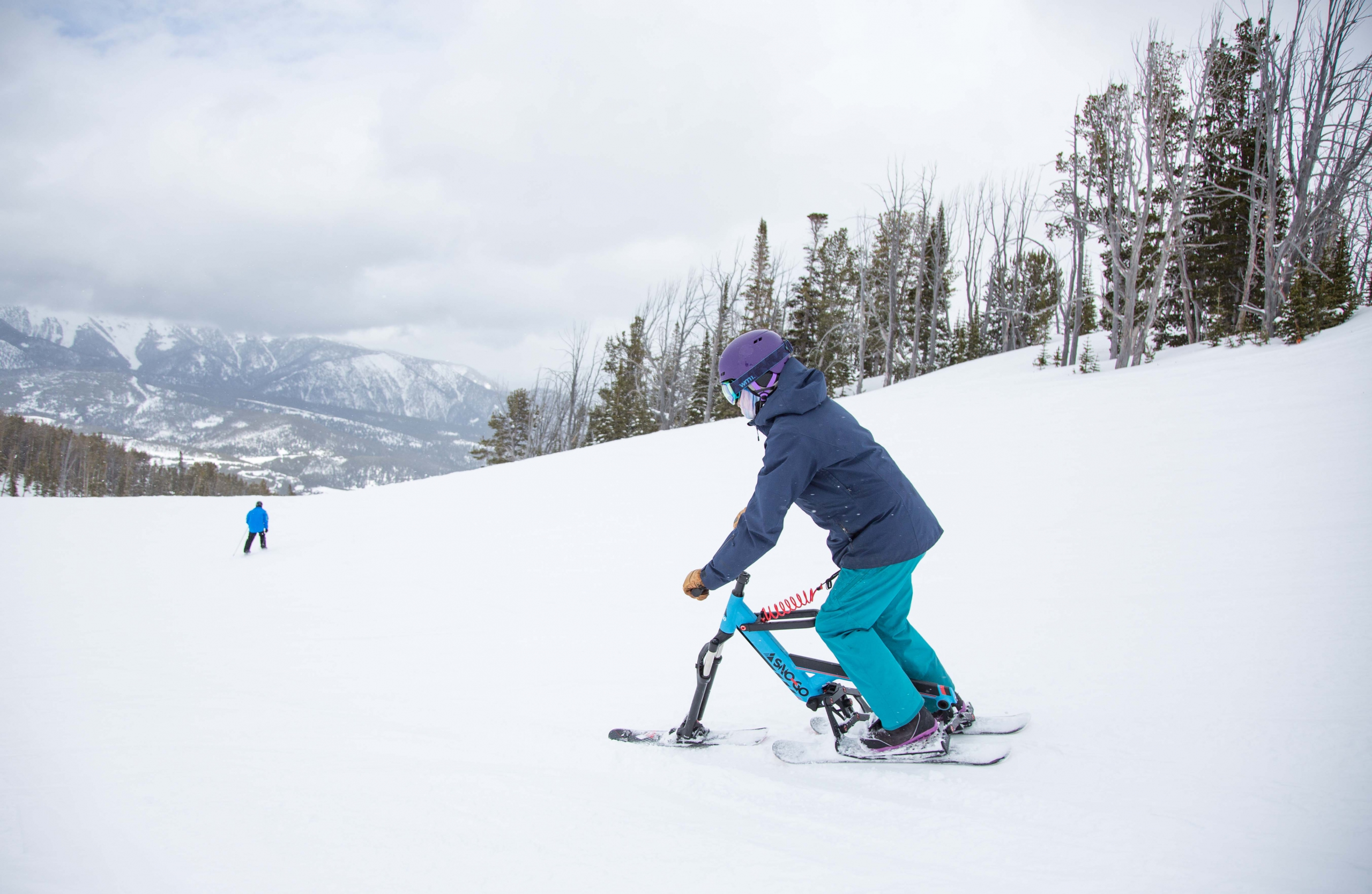 A sno-go rider on the ski trike at Big Sky in Montana