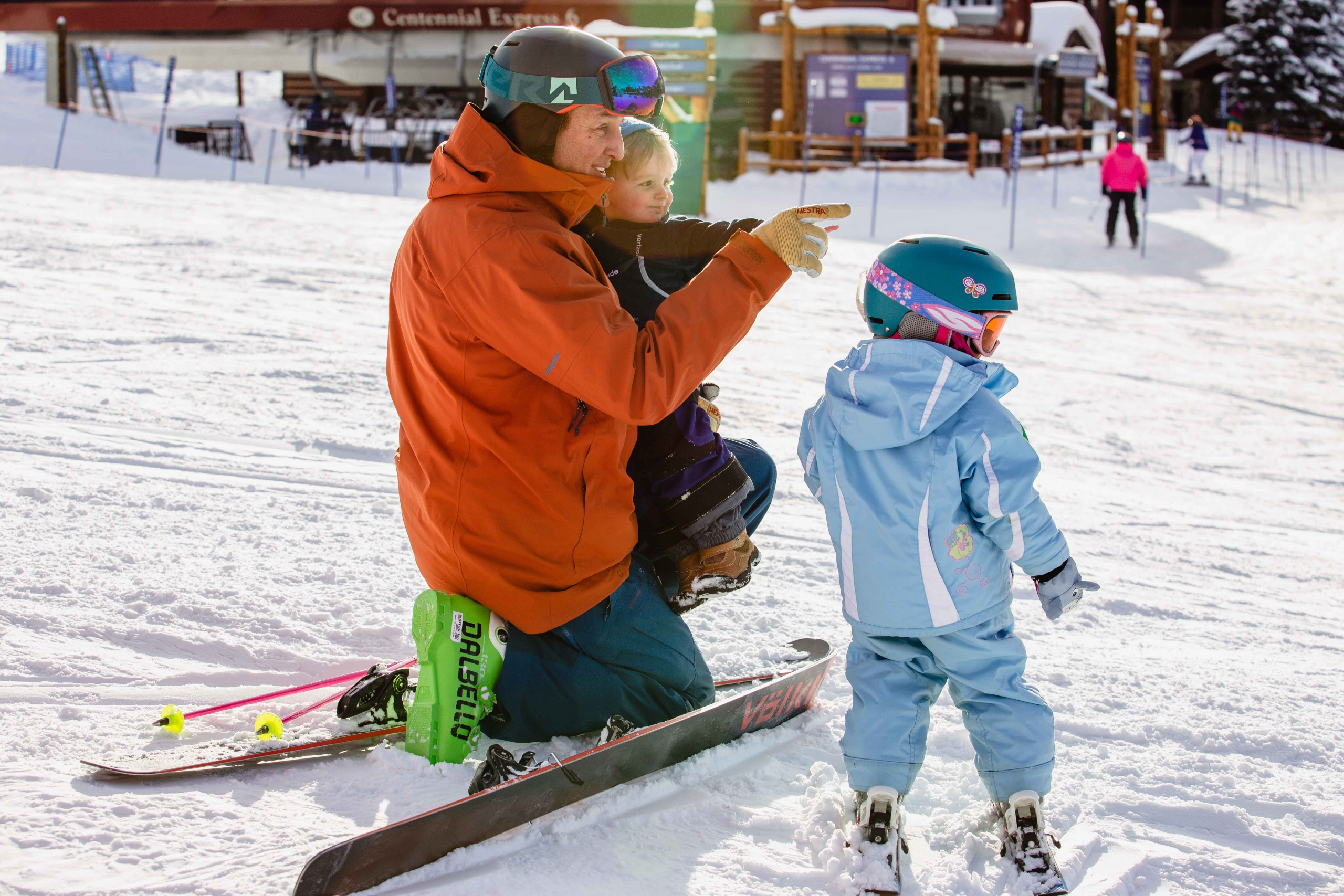 PSIA Alpine Team member Dusty Dyar works with two young skiers