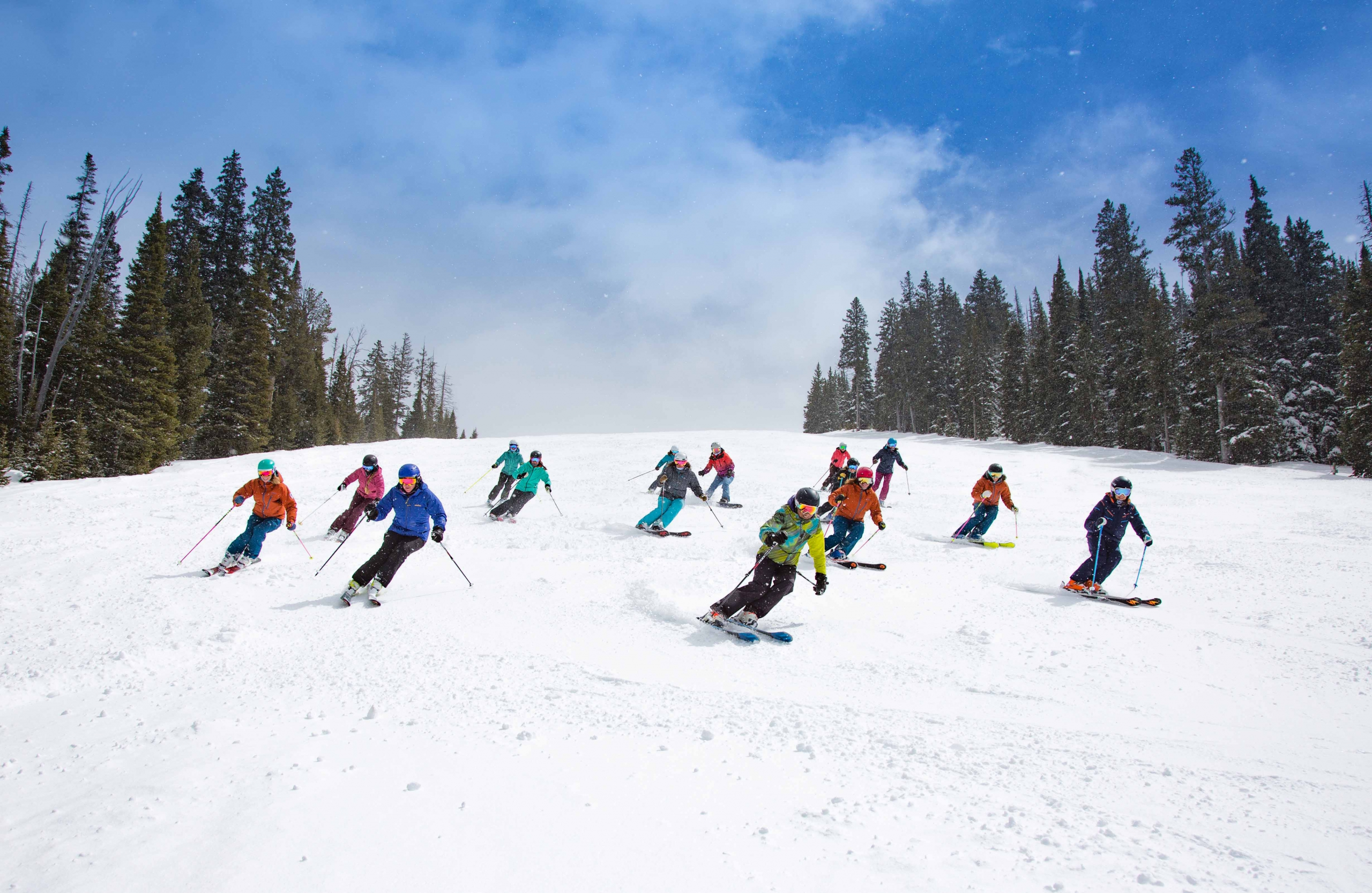 The Nancy Oakes Hall Women's Scholarship Committee skis and snowboards with scholarship recipients
