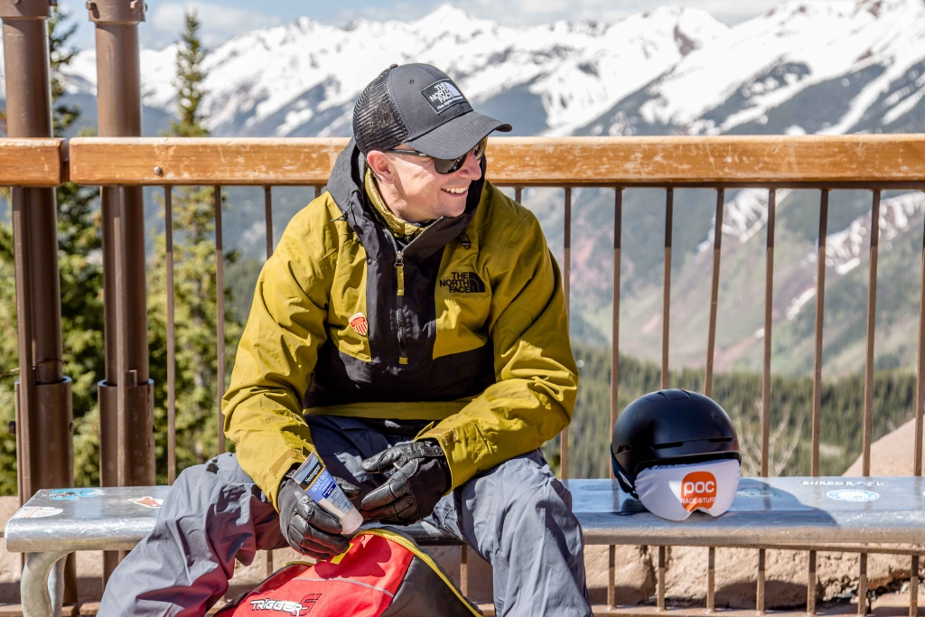 A skier applies sunscreen to get ready for the day skiing